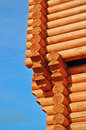 Corner new log house blue sky background Royalty Free Stock Image