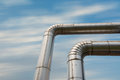 Corner of steam pipeline for industrial. Royalty Free Stock Photo