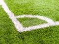 Corner white stripe on the green soccer field Stock Photography