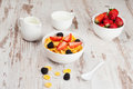 Cornflakes with berries in a bowl and milk for breakfast Royalty Free Stock Photo