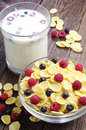 Cornflakes with berries and cup of milk Royalty Free Stock Photo