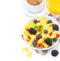 Cornflakes fresh berries cup of cappuccino and orange juice for breakfast isolated on a white background closeup Royalty Free Stock Photo