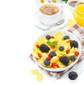Cornflakes fresh berries cup of cappuccino and orange juice fo for breakfast isolated on a white background Royalty Free Stock Photo