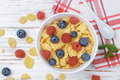 Cornflakes with fresh berries raspberry and blueberry Royalty Free Stock Photo