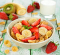 Cornflakes with fruits on a white table Royalty Free Stock Photo