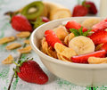 Cornflakes with fruits on a white table Royalty Free Stock Images