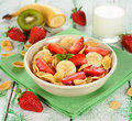 Cornflakes with fruits on a white table Royalty Free Stock Photos