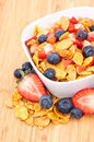 Cornflakes with fruits on wood Stock Photo