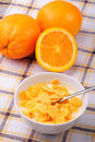 Cornflakes and oranges Stock Photos