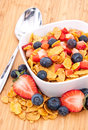 Cornflakes with Strawberries and Blueberries Stock Photos