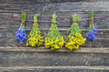 Cornflower and medical st. Johns wort flower bunch on wall Royalty Free Stock Photo