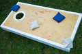 Cornhole game board on grass close up of plain Royalty Free Stock Photos