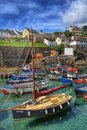 Cornish fishing village a quaint and harbour full of boats Stock Photo