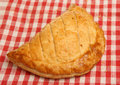 Cornish pasty or pastie on red check napkin Stock Photo