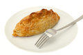 Cornish pasty on a white plate with a fork Royalty Free Stock Photo