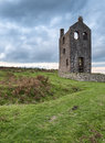 Cornish tin mine an old ruined engine house for a at minions on bodmin moor in cornwall Royalty Free Stock Photo
