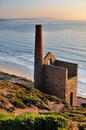 Cornish tin mine st agnes head cornwall pumping engine house at wheal cotes on the coast near in late evening Stock Image