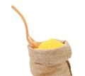 Cornmeal in bag with spoon isolated on a white background Stock Photography