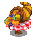 Cornucopia with fruits and vegetables on the table