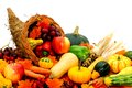 Cornucopia harvest filled with assorted vegetables and fruit Stock Image