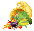 Cornucopia thanks giving or harvest festival golden horn of plenty or abundance full of vegetables and fruit produce Royalty Free Stock Images