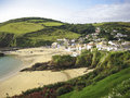 Cornwall small village and beach uk beautiful cornish coastline with old built around harbor Stock Image