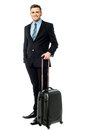 Corpoprate guy all set for business trip businessman holding smart traveller bag Royalty Free Stock Photography