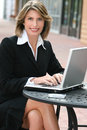 Corporate, Business Woman with Laptop Outdoors Royalty Free Stock Image