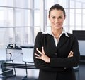 Corporate businesswoman in executive office smiling Royalty Free Stock Images