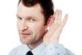 Corporate executive hold hand near ear Royalty Free Stock Photo