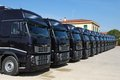 Corporate fleet trucks lined transportation company Stock Photo