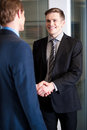 Corporate guys shaking hands handsome young businessmen Royalty Free Stock Photography