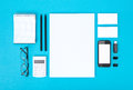 Corporate identity objects set of variety blank office organized for company presentation or isolated on blue paper background Royalty Free Stock Photo