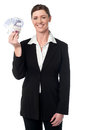 Corporate lady displaying fan of pound sterling smiling female executive holding currency Stock Photo