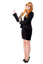 Corporate lady pointing upwards young female executive and looking Stock Images