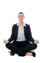 Corporate lady practicing meditation businesswoman meditating in lotus posture Stock Photography