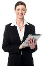 Corporate lady working on tablet device smiling middle aged woman operating pc Royalty Free Stock Image