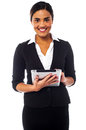Corporate lady working on tablet device smiling young businesswoman operating pc Stock Photography