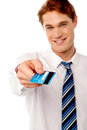 Corporate man offering you credit card young businessman Royalty Free Stock Photo