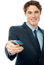Corporate man offering you credit card young businessman debit Stock Photography
