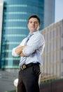 Corporate portrait attractive businessman outdoors urban office buildings