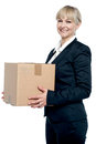 Corporate woman with a cardboard box in hand Royalty Free Stock Photography