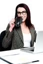 Corporate woman enjoying coffee at work desk Stock Photography
