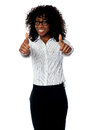 Corporate woman gesturing double thumbs up Stock Photo