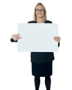 Corporate woman pointing towards blank billboard Royalty Free Stock Photo