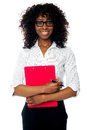 Corporate woman posing with clipboard and pen Stock Image
