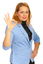 Corporate woman show okay sign hand gesture Stock Photos