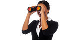 Corporate woman viewing through binoculars young businesswoman hunting success over white Royalty Free Stock Images