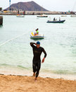 Corralejo april men finish the swimming part of the race fuerteventura triathlon in fuerteventura spain Stock Photo