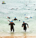 Corralejo april men finish the swimming part of the race fuerteventura triathlon in fuerteventura spain Royalty Free Stock Photography